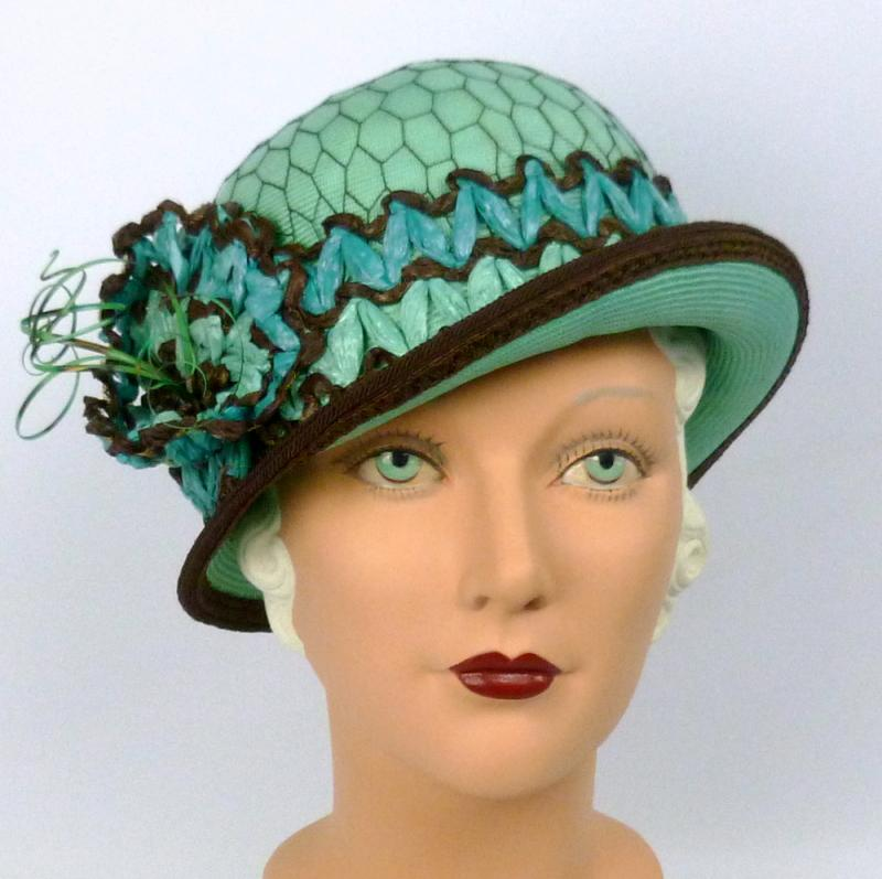 hand blocked straw cloche style hat in aqua and trimmed in deep rich brown