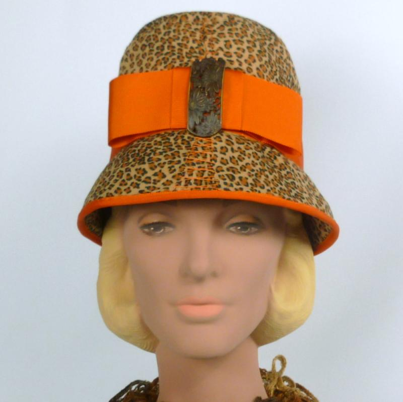 Animal print cloche with burnt orange accents